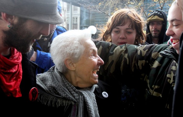 Dorli Rainey, 84, has become an international celebrity after being pepper-sprayed during a march on Tuesday during an Occupy Seattle march. Here she moves to embrace Jennifer Fox, right, who was also sprayed during the protest. (Photo by Alan Berner / The Seattle Times)