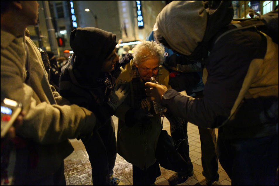 Seattle activist Dorli Rainey, 84, reacts after being hit with pepper spray during an Occupy Seattle protest on Tuesday, November 15, 2011 at Westlake Park. Protesters gathered in the intersection of 5th Avenue and Pine Street after marching from their camp at Seattle Central Community College in support of Occupy Wall Street. Many refused to move from the intersection after being ordered by police. Police then began spraying pepper spray into the gathered crowd hitting dozens of people. Rainey had a milky solution splashed in her face to help with the effect of the pepper spray. (Photo by Joshua Trujillo, seattlepi.com)