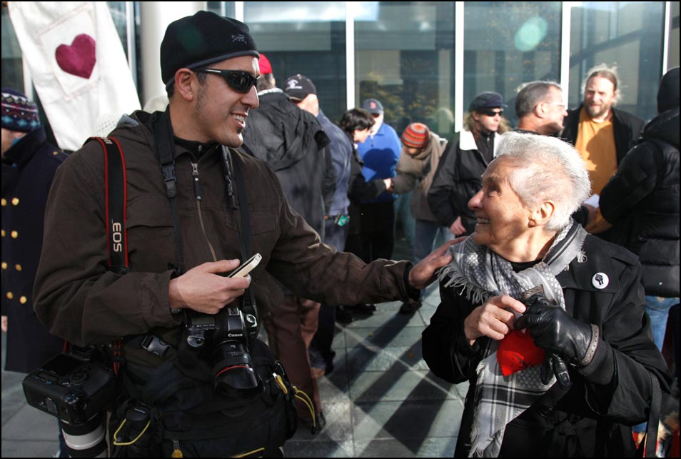 Josh Trujillo is introduced to Dorli Rainey after a press conference on the steps of the Seattle Police Department. Photo by Ted S. Warren, Associated Press